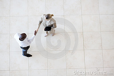 Businessman businesswoman handshake