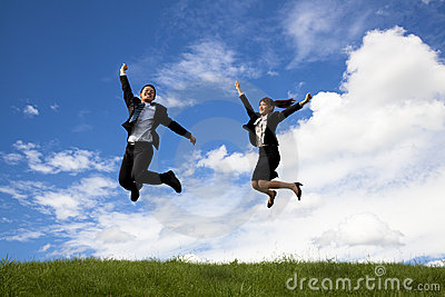 Businessman and businesswoman are jumping