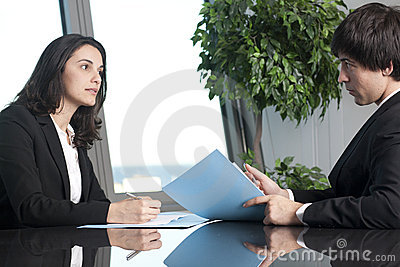 Businessman and businesswoman negotiating