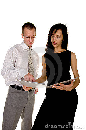 Businessman and businesswoman reading document