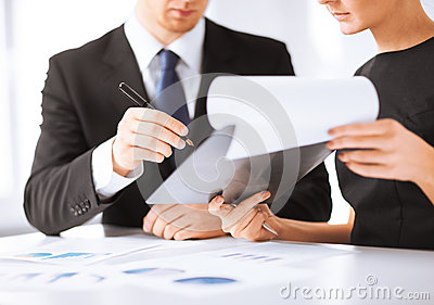 Businessman and businesswoman signing paper