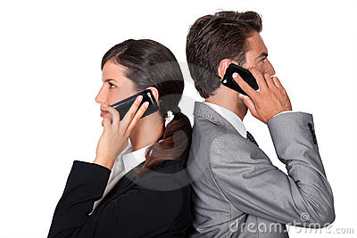 Businessman and businesswoman telephoning
