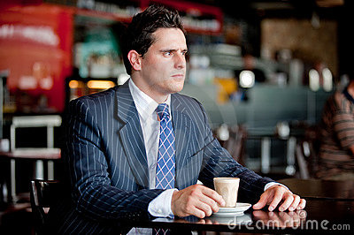 Businessman In Cafe