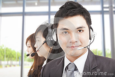 Businessman with call center agent