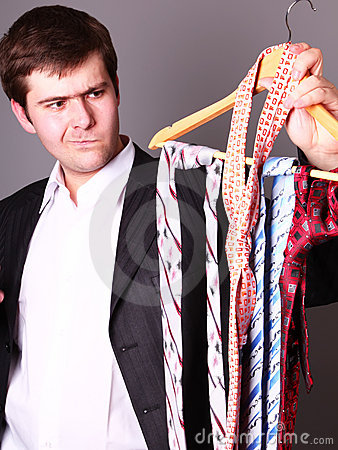 Businessman can t select a tie
