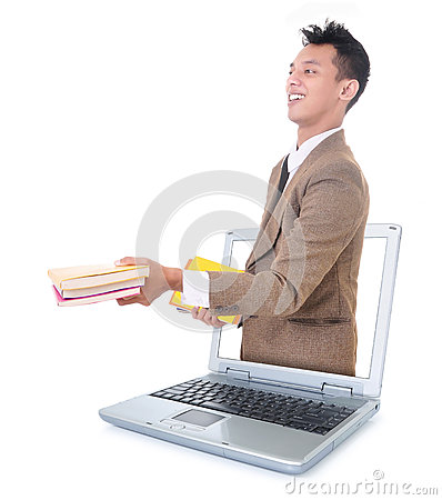 Businessman carrying a book and out of the laptop