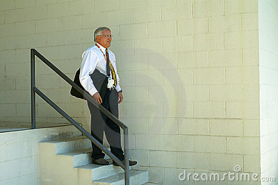 Businessman Carrying Laptop Going Down Steps