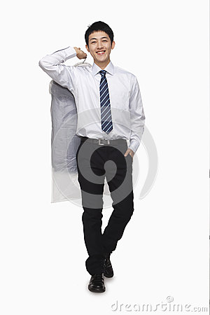 Businessman carrying laundered shirt, studio shot