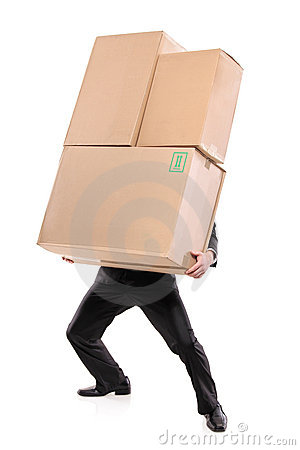 Businessman carrying paper boxes
