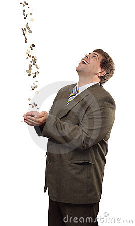Businessman catching falling money