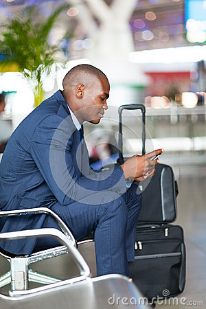 Businessman cellphone airport