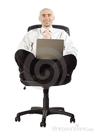Businessman in chair with laptop computer