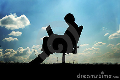 Businessman in chair outside
