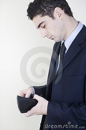 Businessman checking his wallet