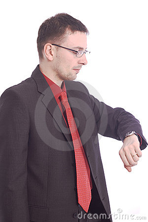 Businessman checking his wristwatch