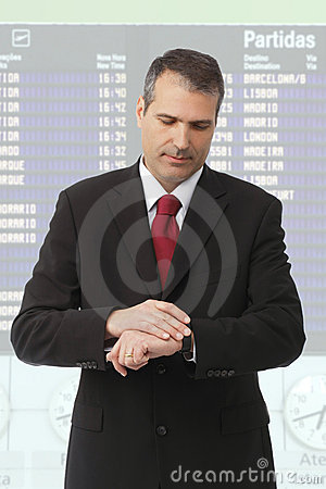 Businessman checking time on his watch