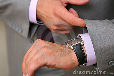 Businessman checking time watch