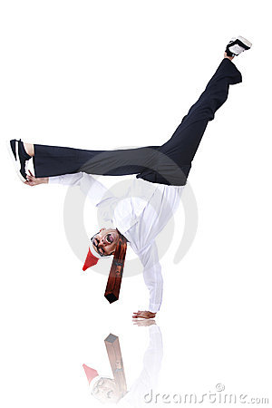 Businessman with christmas hat doing handstand