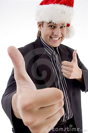 Businessman in christmas hat wishing goodluck