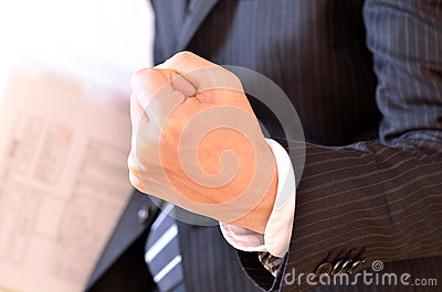 Businessman clenching his hand with the fingers