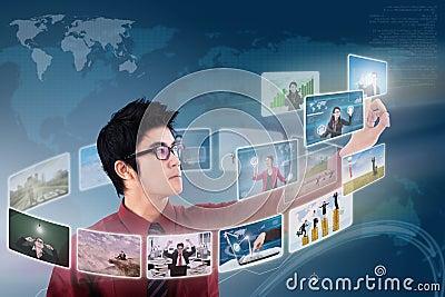 Businessman click on photo touchscreen