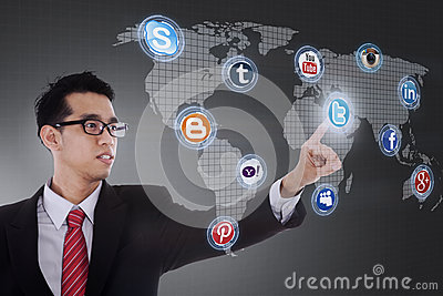 Businessman click on social network icon Editorial Image