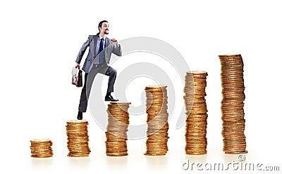 Businessman climbing coins stacks