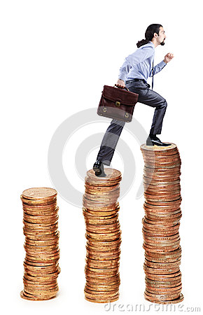 Businessman climbing  coins stacks