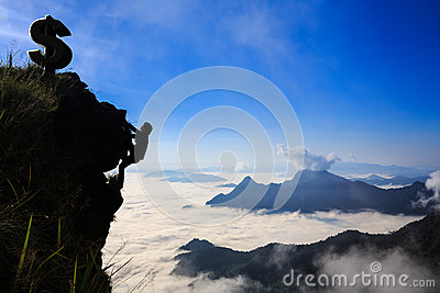 Businessman climbing a mountain