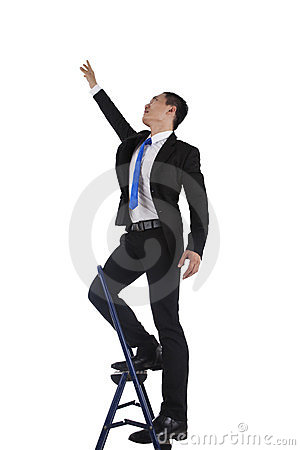 Businessman climbing up a ladder