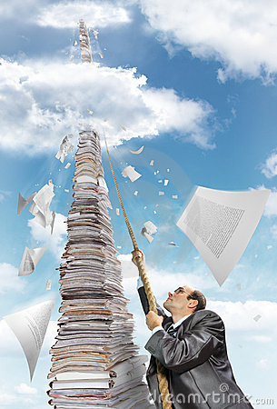 Free Businessman Climbing Up The Pile Of Paperwork Royalty Free Stock Photo - 20803445