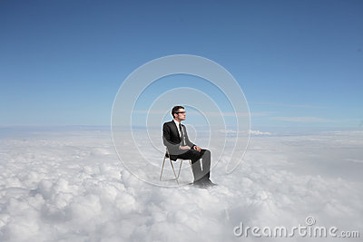 Businessman on a cloud