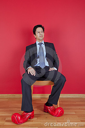 Businessman with clown shoes
