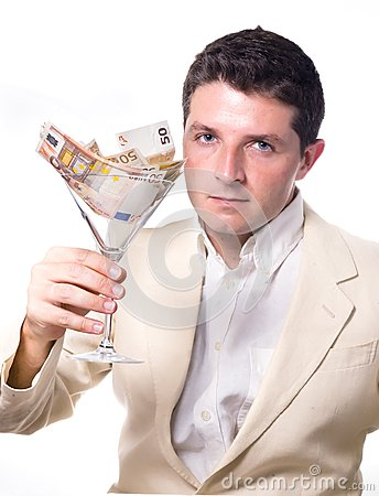 Businessman with Cocktail Glass full of Banknotes