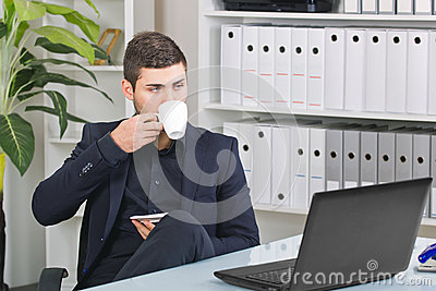 Businessman with a coffee and a computer