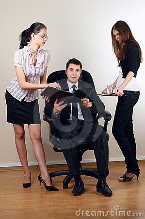 Businessman with collegues in armchair