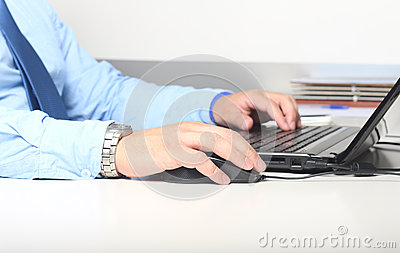 Businessman with computer keyboard