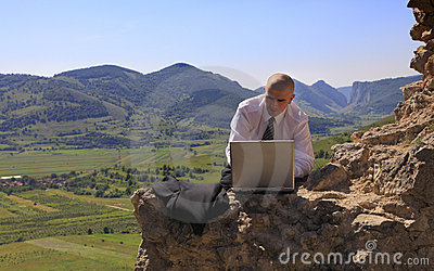 Businessman on a computer outdoors