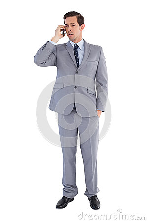Businessman confused while being on the phone