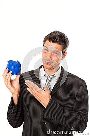 Businessman consulting piggybank