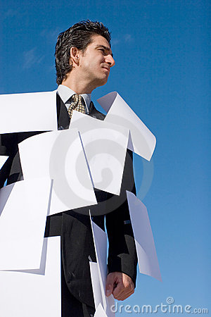 Businessman covered with papers