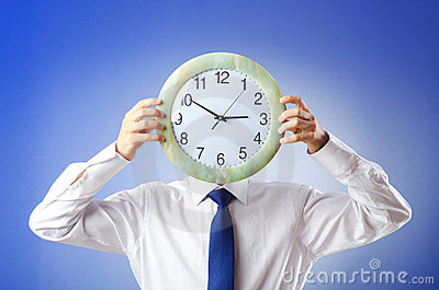 Businessman covering  face with clock