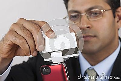 Businessman with credit card swiper