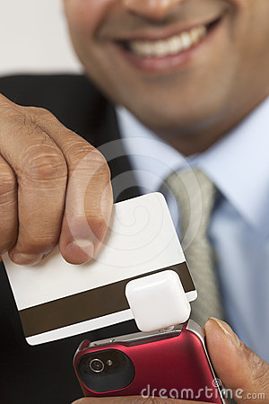 Businessman with credit card swiper