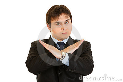 Businessman with crossed arms. Forbidden gesture