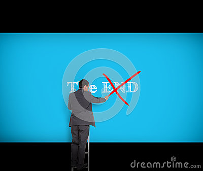 Businessman crossing out the word end