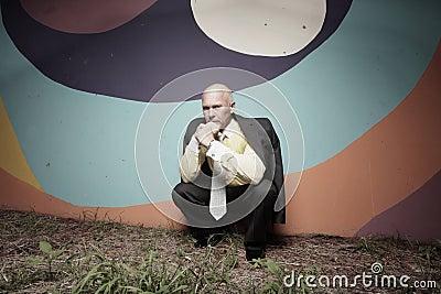 Businessman crouching in the dark