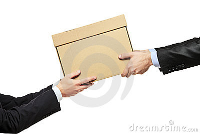 A businessman delivering a package to a man