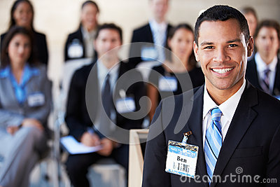 Businessman Delivering Presentation At Conference
