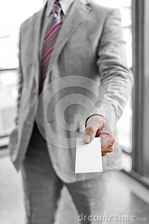 Businessman that delivers a business card
